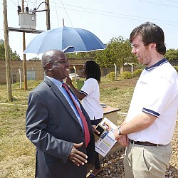 Adam Sweetman with Honourable Earnest Kiiza, Minister of State for Bunyoro Affairs at the official launch